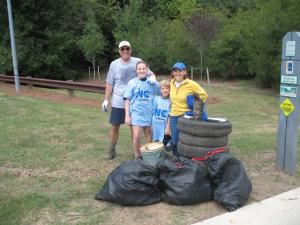 Mark Bruhn and his family carry out the trash they picked up